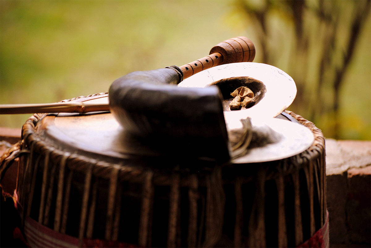 A selection of Bangladeshi music instruments: Dhol (Drum), Pepa (Flute), and Taal (Cymbals)