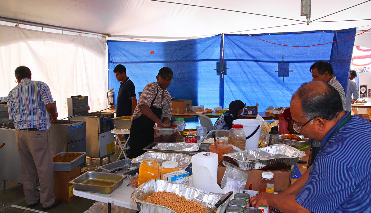 Preparations of food inside the Bangladesh Pavilion