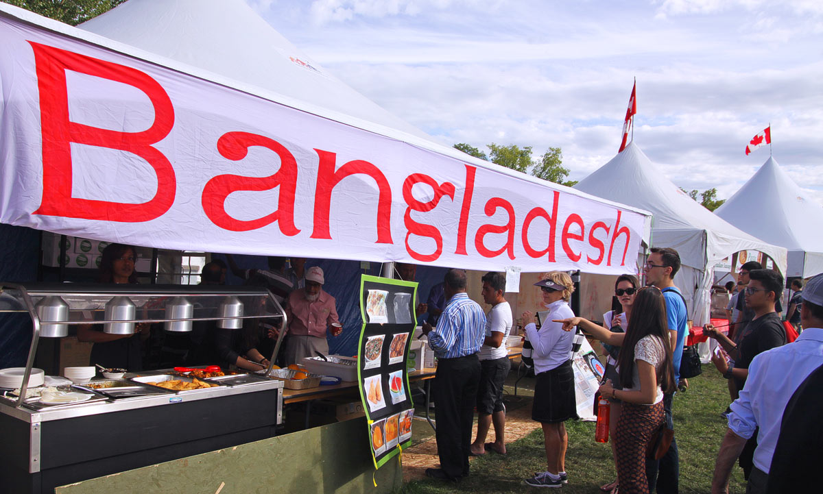 Visitors taste ethnic foods from Bangladesh at the Heritage Festival in Edmonton
